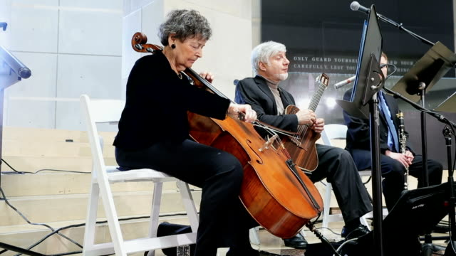 Holocaust survivor and cellist Jacqueline Mendels Birn performs 'Ani Ma'amin ' during a ceremony to commemorate International Holocaust Remembrance...