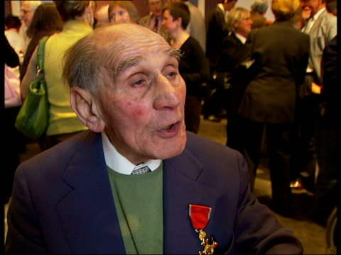 stockvideo's en b-roll-footage met holocaust survivor celebrates 95th birthday at imperial war museum leon greenman interviewed sot this is my auschwitz number my buchewald number is... - imperial war museum museum