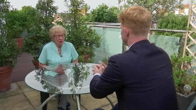 Holocaust survivor Eva Schloss interview ENGLAND London EXT Eva Schloss interview and setup shot with reporter SOT Close shot of stamps with...