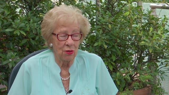Holocaust survivor Eva Schloss interview ENGLAND London EXT Eva Schloss interview and setup shot with reporter SOT