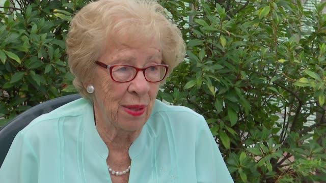 Holocaust survivor Eva Schloss interview ENGLAND London EXT Eva Schloss interview SOT Pages of book being flicked through Paula Fouce interview SOT