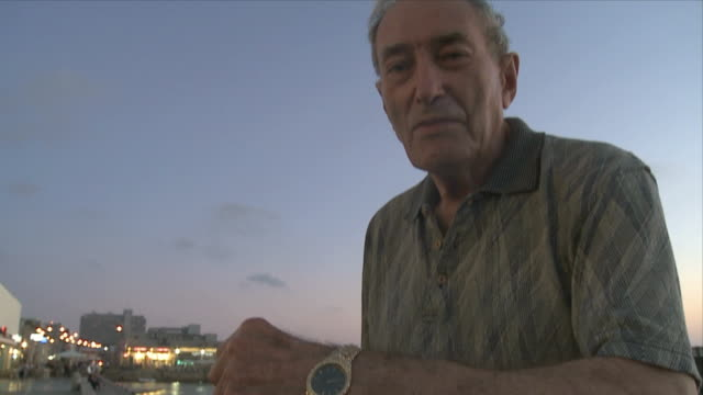 CU TD Holocaust survivor showing camp tattoo / Tel Aviv, Dan metropolitan, Israel
