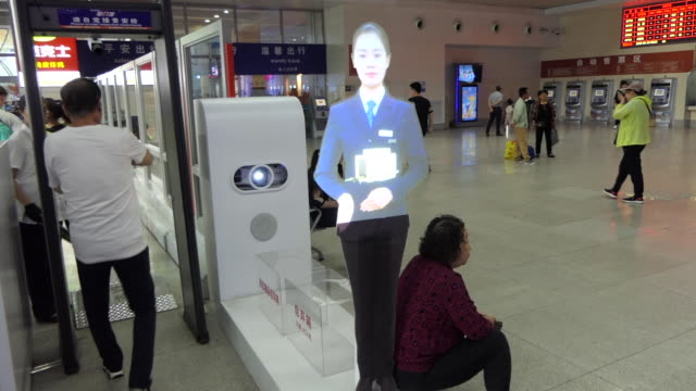 hologram in a train station in china security check - hologram stock-videos und b-roll-filmmaterial
