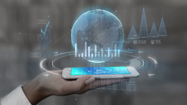 holographic interface of statistics and data on smartphone held by unrecognizable person on hand - hologram stock videos & royalty-free footage