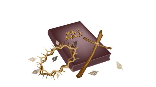 sacra bibbia e la croce di legno e corona di spina delle piante - nuovo testamento video stock e b–roll