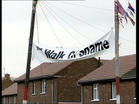holy cross protest called off itn gv amoured landrovers and soldiers on guard outside entrance to holy cross primary school la gv banner 'walk of... - walk of shame stock videos & royalty-free footage