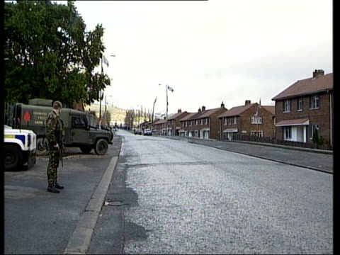 holy cross protest called off itn northern ireland belfast ardoyne ext gv amoured landrovers and soldiers on guard outside entrance to holy cross... - walk of shame stock videos & royalty-free footage