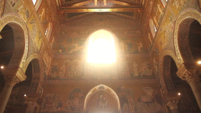 'holy light' spill through a window in the stunningly ornate, gilded cathedral of monreale in palermo, sicily, italy - religion stock videos & royalty-free footage