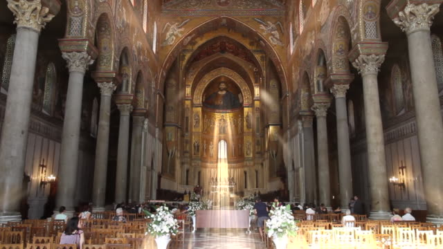'holy rays of light' highlight a bridal party in the stunningly ornate, gilded cathedral of monreale in palermo, sicily, italy - cathedral stock videos & royalty-free footage