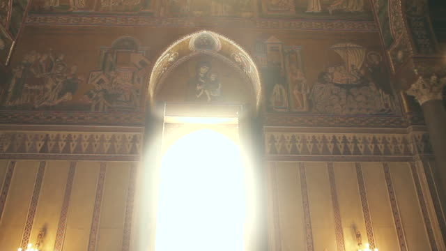 'holy rays of light' spill through a window in the stunningly ornate, gilded cathedral of monreale in palermo, sicily, italy - column stock videos & royalty-free footage