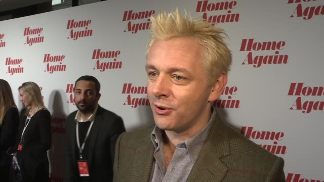 'home again' premiere: red carpet and interviews; actor michael sheen interview sot - on hair and film - michael sheen bildbanksvideor och videomaterial från bakom kulisserna