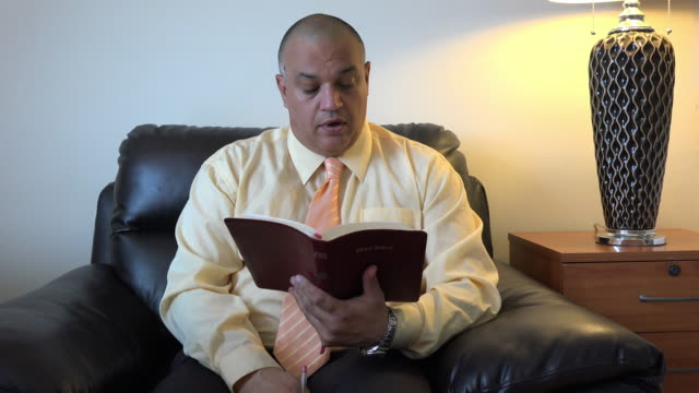home bible study: a christian male leader teaching christianity in a private house - pastor stock videos & royalty-free footage