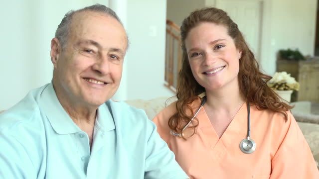 home caregiver and male patient - nursing assistant stock videos and b-roll footage