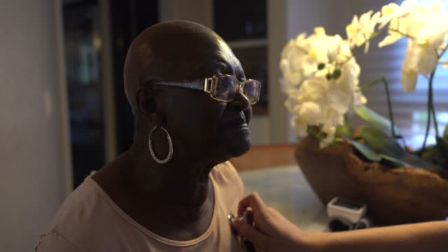 home caregiver examining senior woman - social services stock videos & royalty-free footage