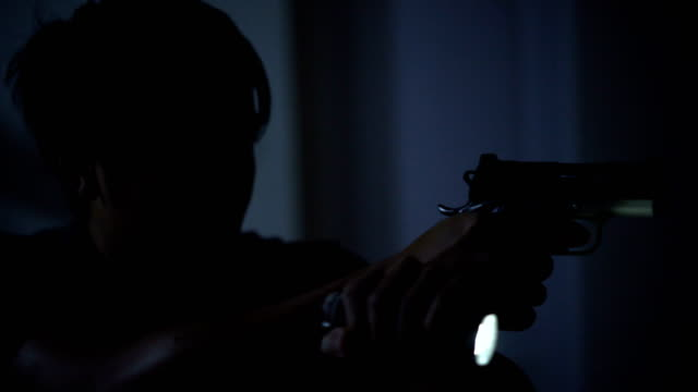 4k home defense concept, asian man holding pistol and flashlight at night. - handgun stock videos and b-roll footage