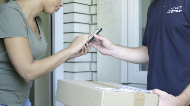 home delivery of a box to the client - receiving stock videos & royalty-free footage