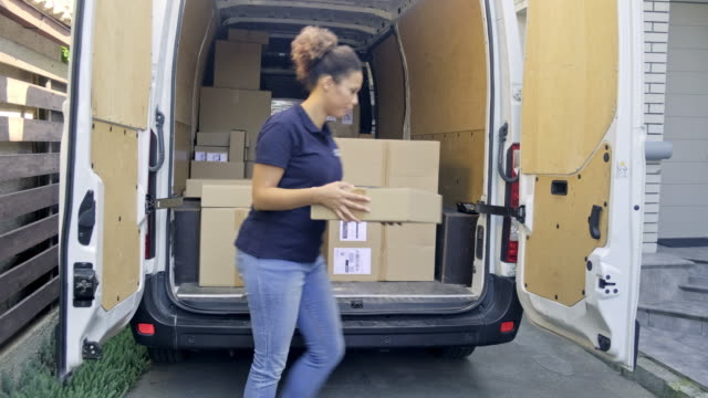 home delivery of a box to the client - caucasian ethnicity stock videos & royalty-free footage