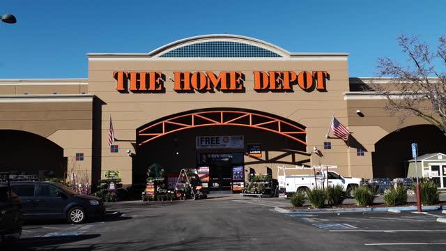home depot store entrance in pleasanton, california, u.s., on monday, february 22, 2021. - catena di negozi video stock e b–roll