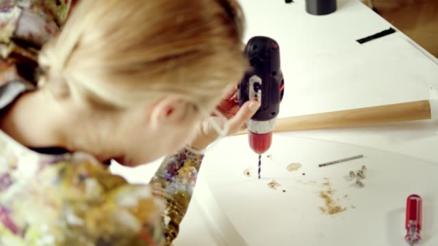 home diy. woman fixing furniture. - drill stock videos & royalty-free footage