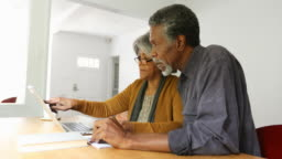 Home Finances On Computer by African American Senior Couple