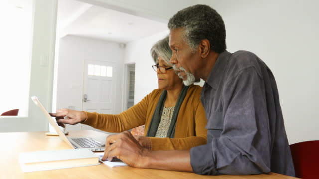 home finances on computer by african american senior couple - african american ethnicity stock videos & royalty-free footage