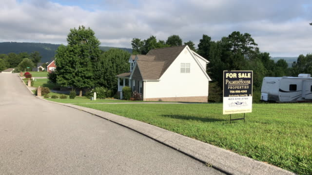 home for sale sign in north georgia, usa, amid the 2020 global coronavirus pandemic - sign stock videos & royalty-free footage