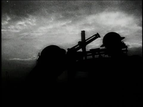 1947 reenactment home guard soldiers preparing to fire anti-aircraft gun / united kingdom - home guard britannica video stock e b–roll