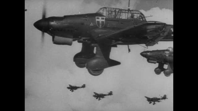 home guards patrol the british coastline as germans fly overhead, bombing ships in the english channel - luftwaffe stock-videos und b-roll-filmmaterial