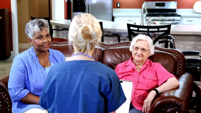 home healthcare nurse evaluates senior adult patients at nursing home. - community outreach stock videos & royalty-free footage