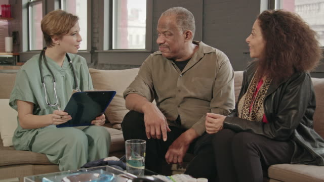 Home Healthcare Provider Visits Senior Couple