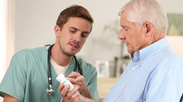 Home healthcare worker discussing prescription with senior patient