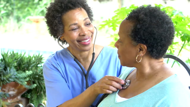 home healthcare worker examining senior woman - stethoscope stock videos & royalty-free footage
