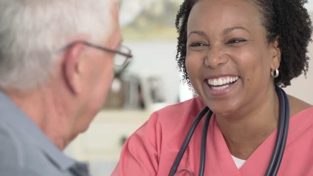 Home Healthcare Worker helping Senior Man