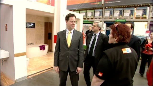 home insulation scheme: nick clegg and chris huhne visit b&q store; england: london: sutton: int various shots of nick clegg mp and chris huhne mp... - クリス ヒューン点の映像素材/bロール