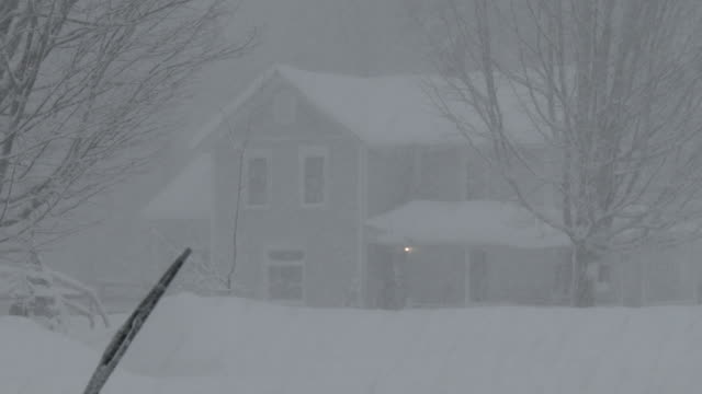a home is barely visible through heavy snow and near whiteout conditions during a lake effect snowstorm in adams new york - scott mcpartland stock videos & royalty-free footage