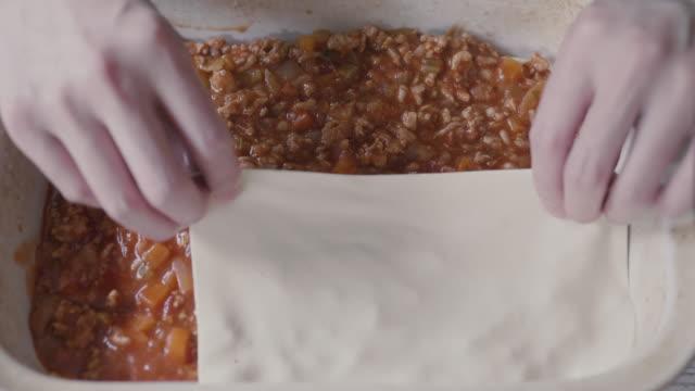 home made beef lasagna at home kitchen - lasagna stock videos & royalty-free footage