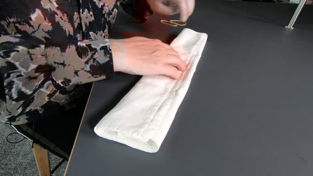 home made face mask or face covering being made with handkerchief and elastic bands during the coronavirus pandemic glasgow - home made stock videos & royalty-free footage