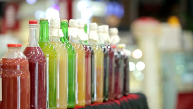 home made organic juices in bottles - detox stock videos & royalty-free footage