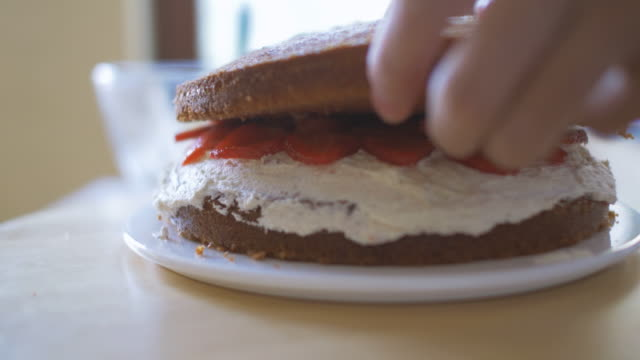 home making strawberry victoria  sponge cake - cake stock videos & royalty-free footage