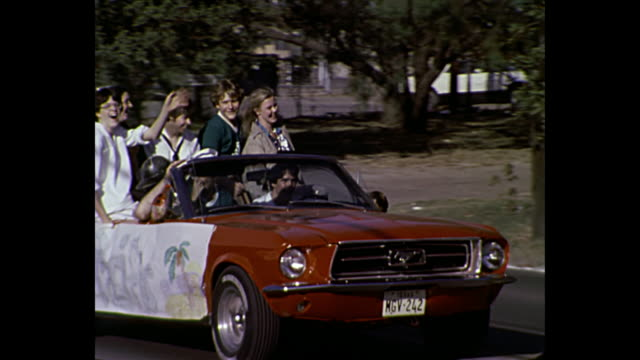 1980 Home Movie - 1960s Convertible Red Mustang in parade, Irving, Texas.