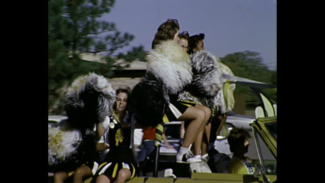 1980 home movie - baton twirlers and cheerleaders in parade - parade stock videos & royalty-free footage