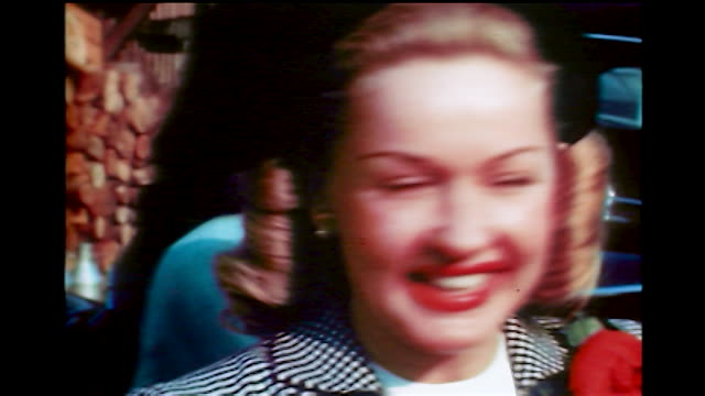 vidéos et rushes de home movie betty grable as she smiles for the camera. - actrice