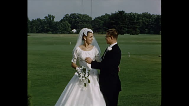 1957 Home Movie - Bride and Groom pose for camera