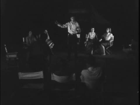 home movie captures the cast of a play rehearsing in 1960s waco. - リハーサル点の映像素材/bロール
