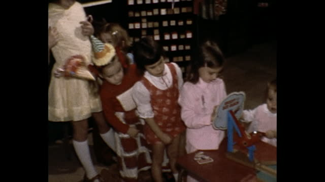 1975 home movie - children at birthday party - papier stock videos & royalty-free footage