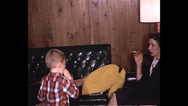vídeos de stock, filmes e b-roll de 1961 home movie - children's birhday party - smoking