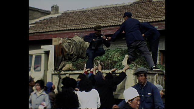1969 home movie - china / people buying vegetables from truck - comunismo video stock e b–roll