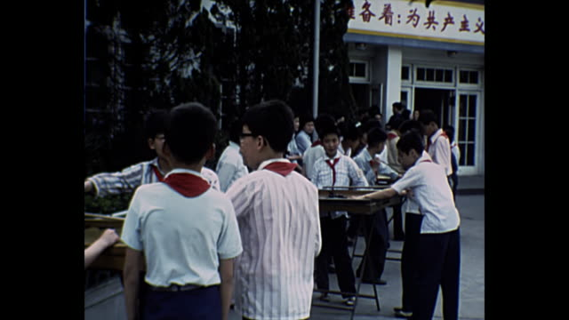 1969 home movie china / school children in playground - comunismo video stock e b–roll