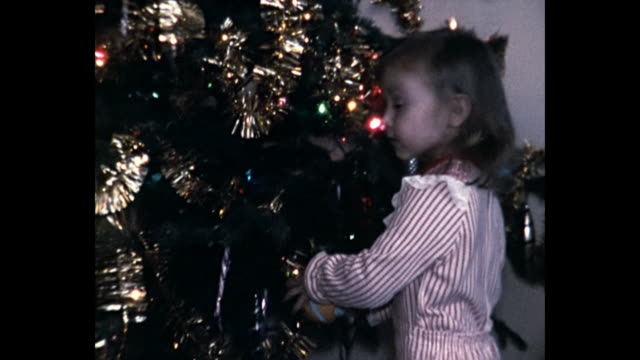 1973 home movie christmas morning - decorating the christmas tree stock videos & royalty-free footage