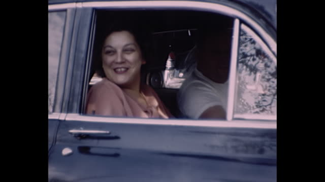 1955 home movie - different shots of people with their vintage cars - caricare attività video stock e b–roll